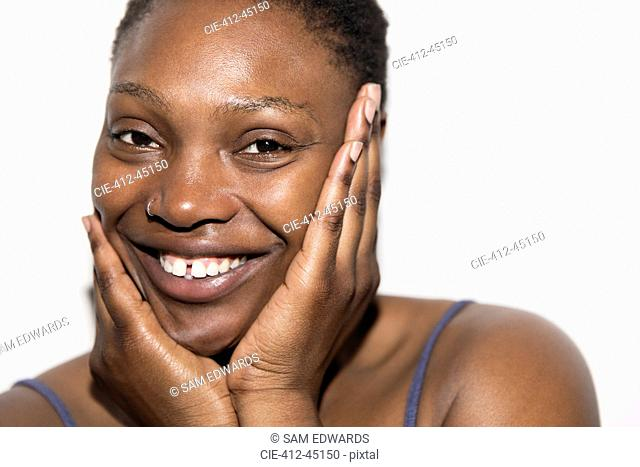 Close up portrait smiling woman with head in hands
