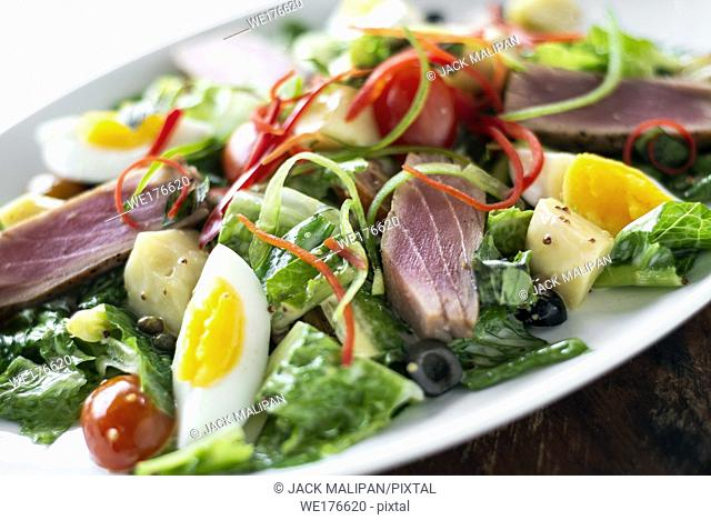 fresh seared raw tuna fish and mixed vegetable salad with mustard sauce