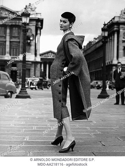 A woman wearing Lanvin Castillo's clothes. A woman wearing a black and white tweed dress and a coat by the French stylist Lanvin Castillo. 1956