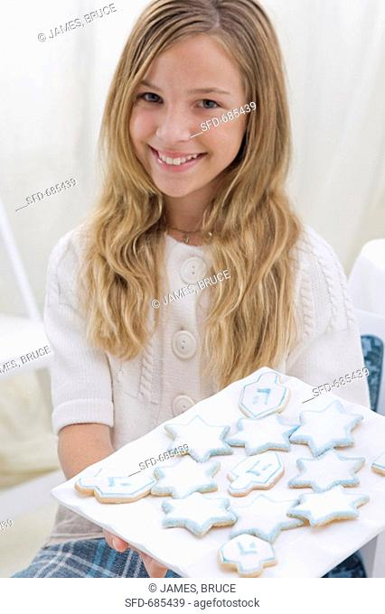 Young Girl Holding Platter of Chanukah Cookies