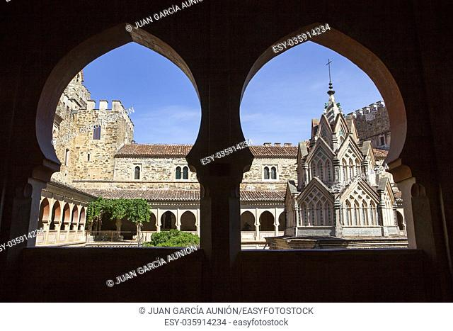 Central building of Guadalupe Monastery cloister from open arcade. Upper floor. Caceres, Spain