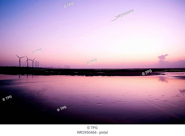 The sea reflect the sky in Peaceful evening