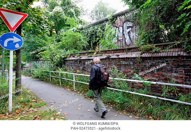 An original section of the Berlin Wall stands overgrown with plants on Liesenstrasse near Bernauer Strasse in Berlin, Germany, 2 October, 2014