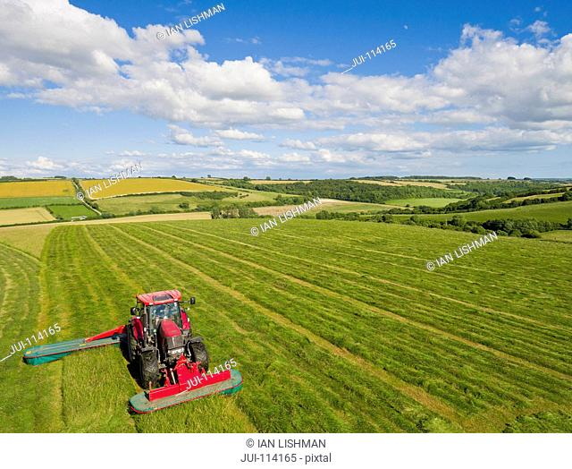 Aerial View Of Tractor In Field Cutting Grass To Make Silage