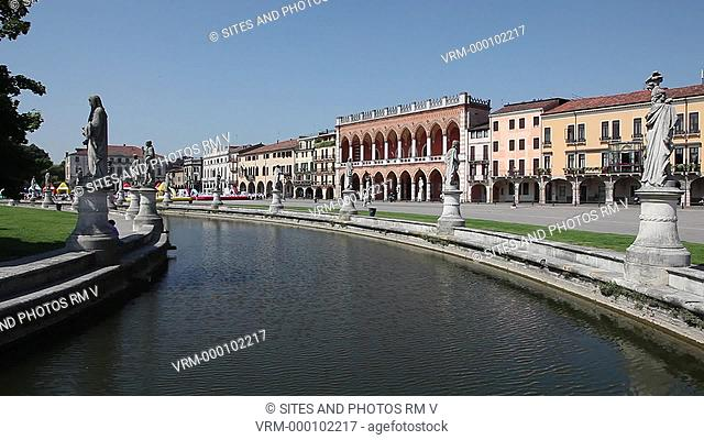 Exterior, LS, Locked Down Shot, Daylight, view of the Prato della Valle, a 90,000 squared meters elliptical square, whose construction begun in late 18th...