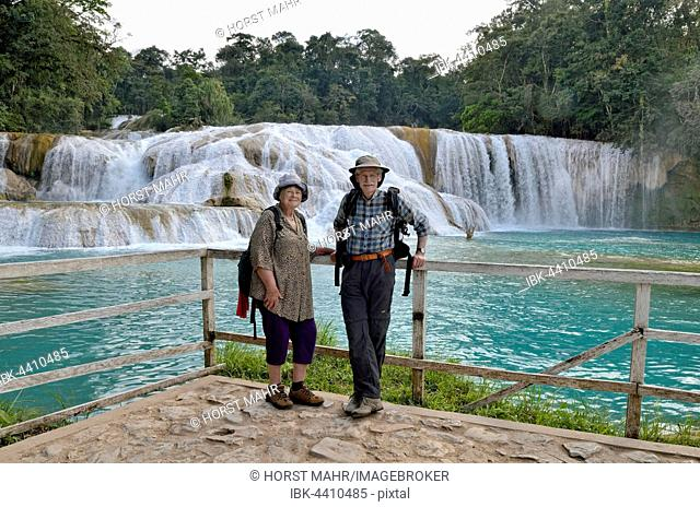 Tourists are standing at the Agua Azul blue water waterfalls, Palenque, Chiapas, Mexico
