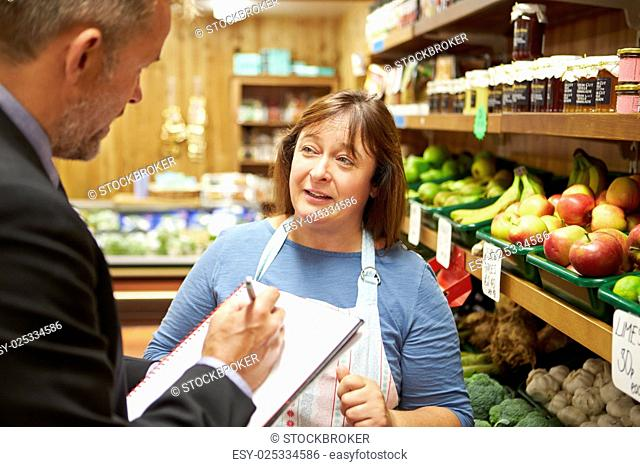Bank Manager Meeting With Female Owner Of Farm Shop