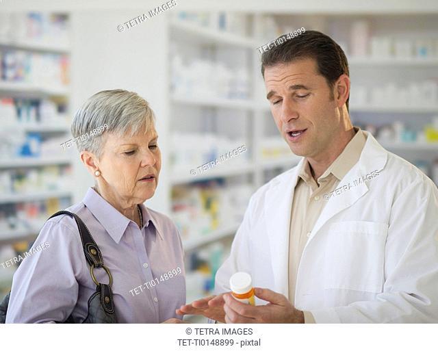Senior woman talking to pharmacist