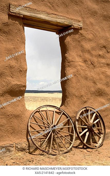 Fort Union National Monument, fort operational from 1851-1891, old wagon wheels with remnants of Fort Union (background). New Mexico, USA