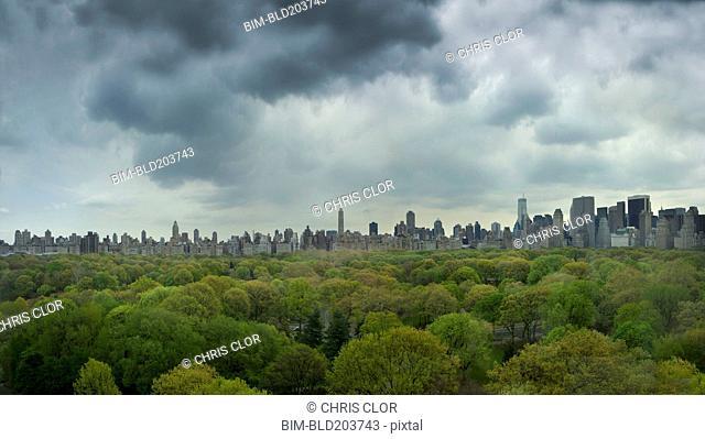 Urban park and city skyline, New York, New York, United States