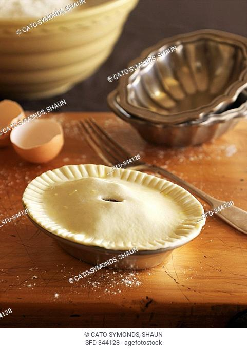 Still life with unbaked pie in pie dish