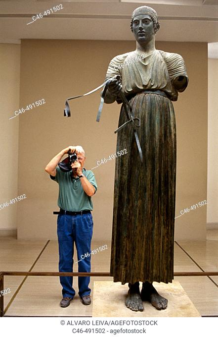 The Charioteer, bronze statue erected in 474 BC to commemorate the victory of a chariot team in the Pythian Games (which were held at Delphi) now in the Delphi...