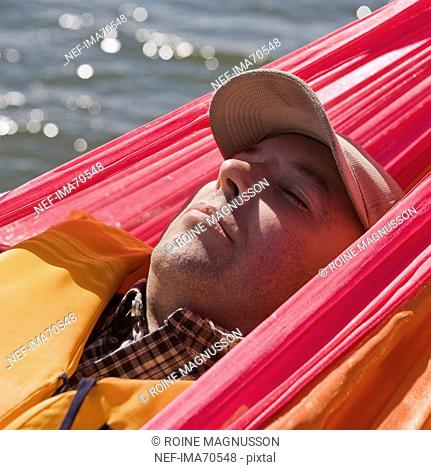 A man lying in a hammock Sweden
