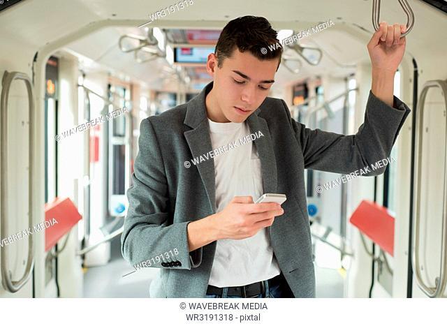 Man using mobile phone in bus