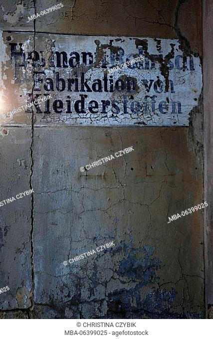 Wall of a house, advertisement sign, old, derelict