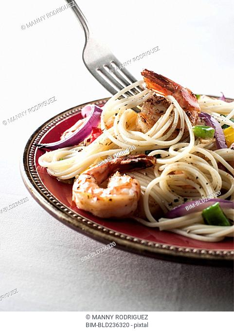 Fork twirling spaghetti with shrimp