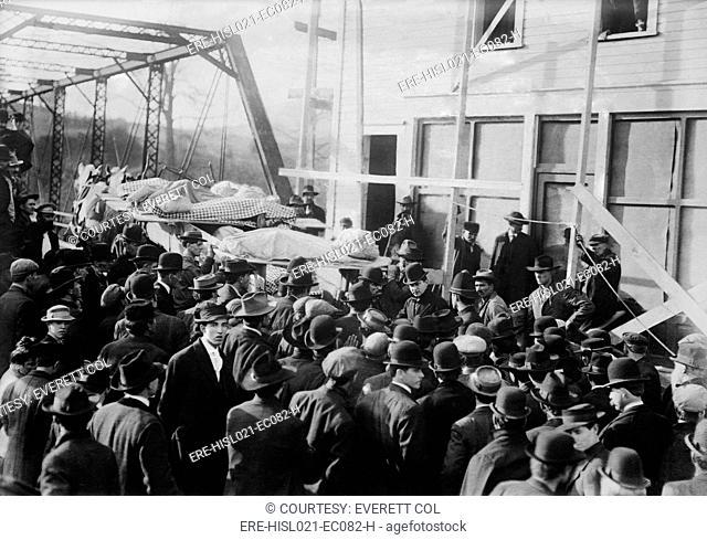 Shrouded victims of the Marianna Mine loaded onto a horse drawn wagon. The coal mine explosion on November 30, 1908 killed 154