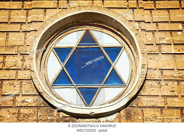Blue star of David in the window