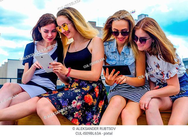 Friends on vacation using digital tablet