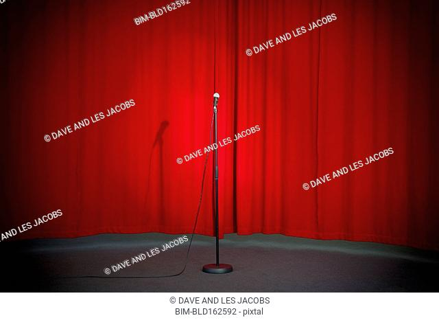 Empty microphone in spotlight on stage