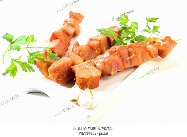 beef skewers marinated pork on white tray