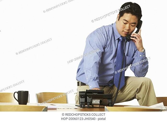 Close-up of a businessman using the telephone