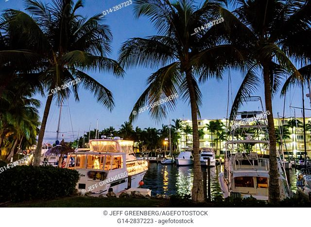 Florida, Key Largo, Upper Florida Keys, Courtyard Key Largo, waterfront, canal, marina, yachts, boat, slip, palm tree, dusk, night, twilight