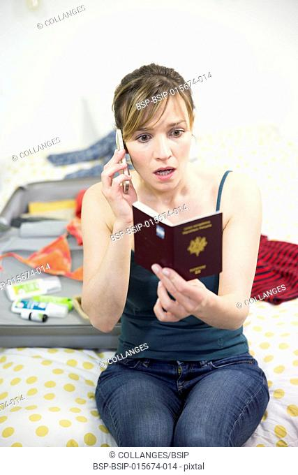 Woman on the phone, holding her passport