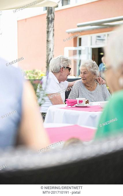 Senior women sitting outdoors