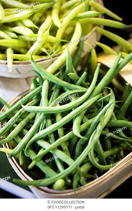 Green and yellow beans at a market