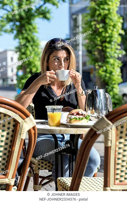 Woman in outdoor cafe