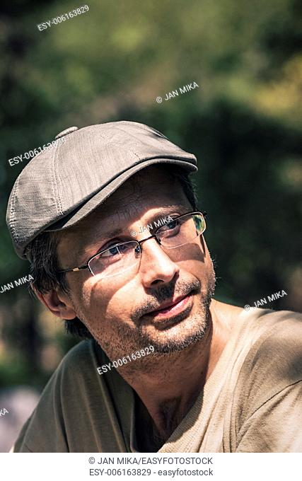 Closeup of middle aged pensive man outdoors