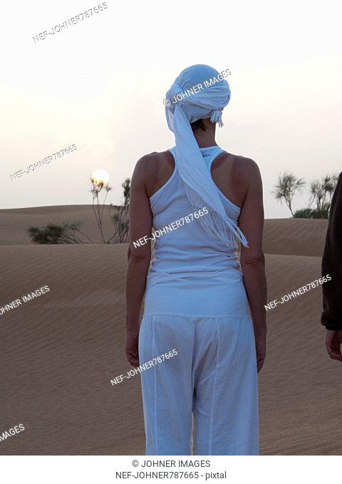 Woman looking at the sunset, Tunisia