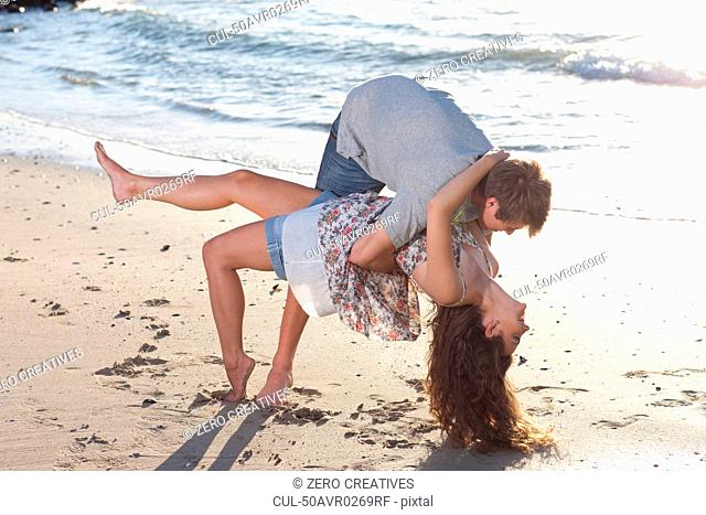 Couple playing together on beach