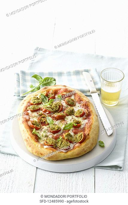 Pizza wth stuffed tomatoes and basil