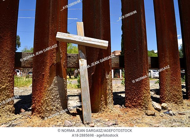 A cross sits at the wall that indicates the international border with Nogales, Arizona, USA, as seen from Nogales, Sonora, Mexico