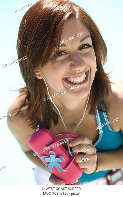 Young Woman with Pink Purse Smiling Portrait