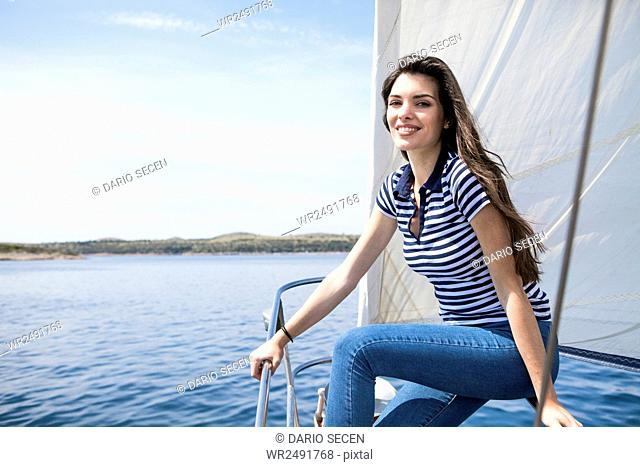 Portrait of Woman on sailboat with brown hair