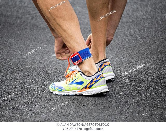 Triathlete wearing electronic timing chip on ankle during competition
