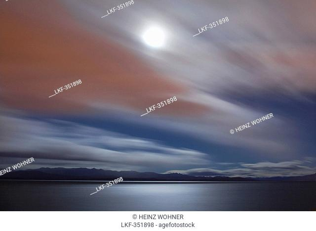 Moonlight breaking through the clouds, view over Lago Nahuel Huapi, near San Carlos de Bariloche, Rio Negro, Patagonia, Argentina