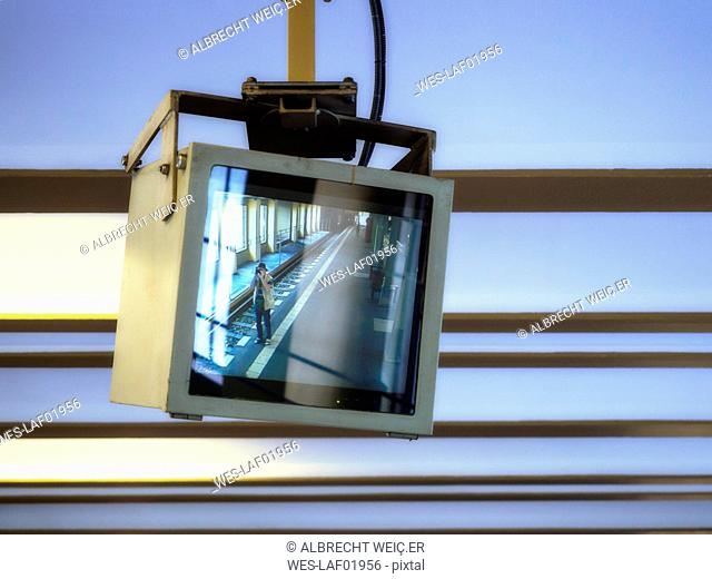 Germany, Berlin, Screen from video surveillance, photograper at S-bahn station