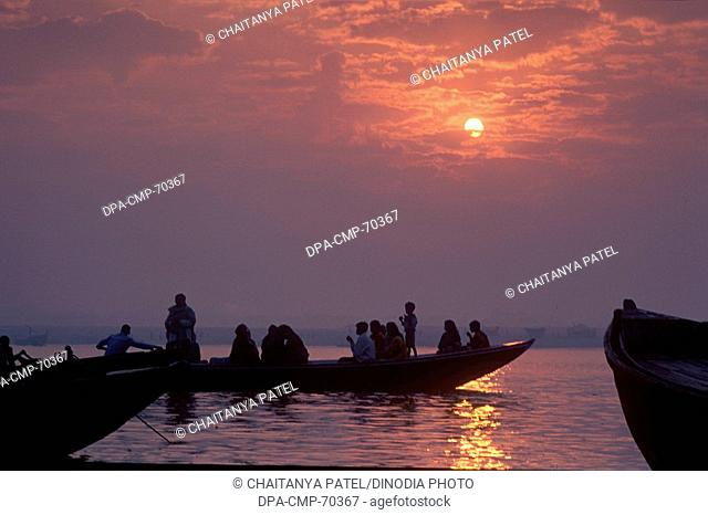 Sunrise at the holy river ganga in the oldest Indian city of India , Banaras now Varanasi , Uttar Pradesh , India