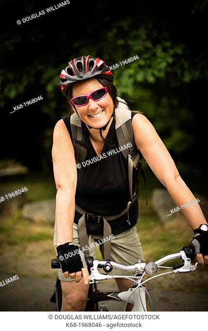A woman, 40, bicycles on Saturna Island, Gulf Islands, British Columbia, Canada