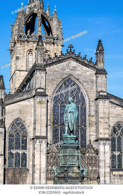 A statue of Walter Montagu Douglas Scott, 5th Duke of Buccleuch, proudly stands in front of the St. Giles cathedral in Edinburgh, Scotland, UK