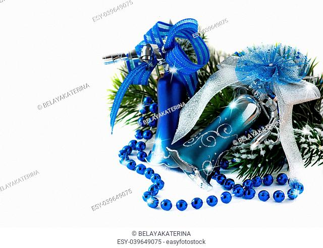 Blue Christmas decoration bells on light background, selective focus, copy space