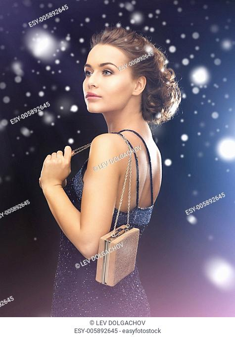 luxury, vip, nightlife, party concept - beautiful woman in evening dress with small bag