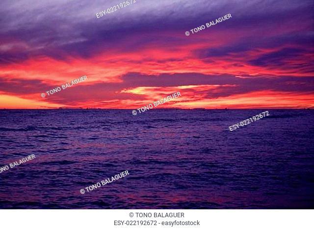 Red and blue sunrise in Mediterranean sea