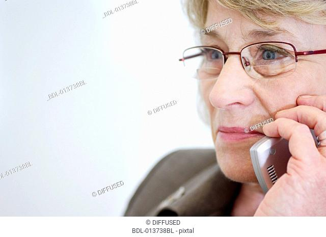 close-up of mature businesswoman with mobile