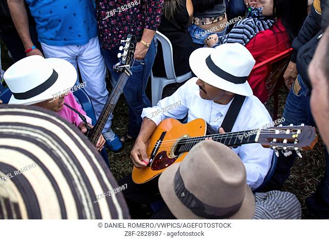Peasant musicians playing guitars at the celebration of the rural parties of the municipality of Carmen de Viboral, Colombia
