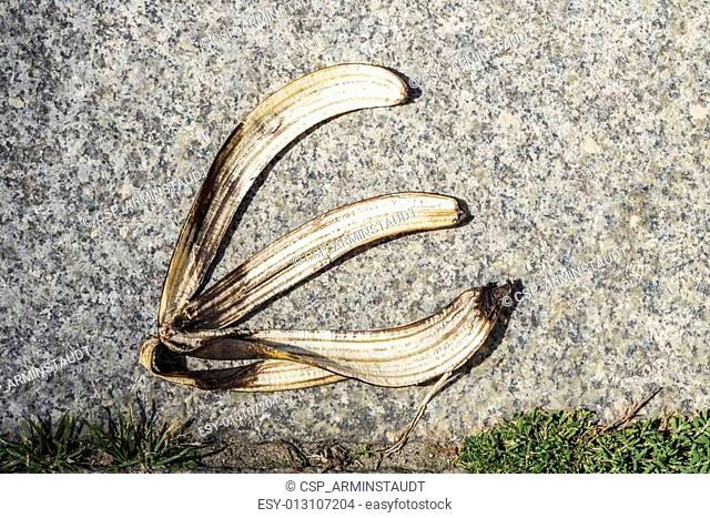 banana peel on pavement